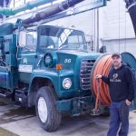 Edmore Department of Public Works employee Tim Shinabargar stands next to a used vactor truck Edmore recently purchased for $10,000. Shinabargar has already used the vactor truck and says it makes a difference on projects. — Daily News/Meghan Nelson