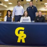 Belding senior Hallee Breimayer, center, signed a letter of intent to play basketball at Grand Rapids Community College Wednesday. Surrounding her are, from left in front, her mother, Shawn, Belding girls basketball coach Connor Hoke; in back, her father, Shad, and her new basketball coach, Dave Glazier. (Daily News | Ryan Schlehuber)