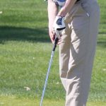 Tri County's Andrew Houghton watches his putt on the 18th green during the CSAA jamboree Monday at Brookside Golf Course.