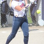 Montabella's Hanna Stockwell swings at a high pitch during the Mustangs' first game against Breckenridge on Tuesday.