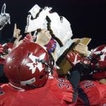 Players from Powers North Central celebrate with the eight-player football title they won Nov. 26, 2016, at Legacy Field in Greenville. The MHSAA is moving the eight-player finals to the Superior Dome starting this fall.