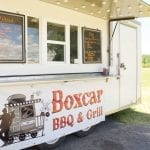 Racks of ribs and chicken quarters cook on Boxcar BBQ & Grill's smoker. The food truck is located on M-91 next to Tractor Supply Company (TSC). —Daily News/Meghan Nelson