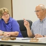 Eureka Township Supervisor Rod Roy, right, explains the details behind an amendment to the township's zoning ordinance, effectively placing a prohibition on medical marijuana dispensaries, compassion clubs and provisioning centers, as Treasurer Cindy Hanson listens Monday evening. —Daily News/Cory Smith