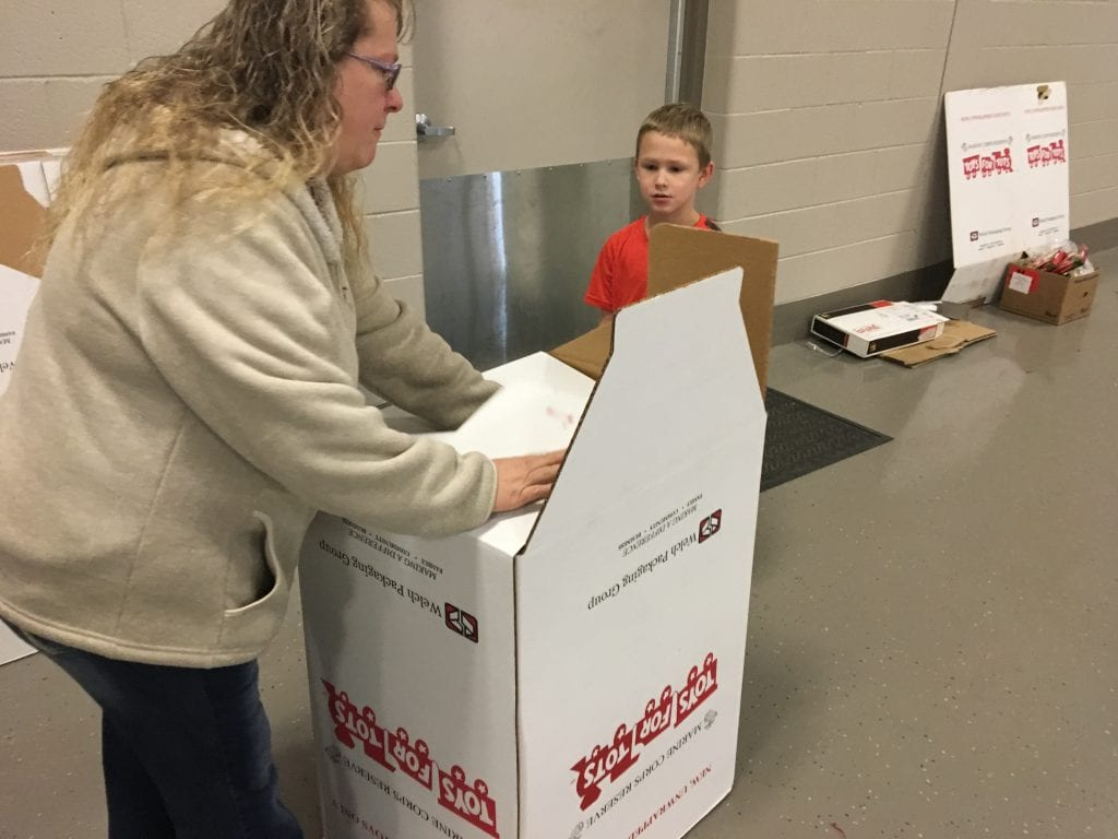 Sue Of Langston And Rylan 7 Assemble A Donation Box For The Next Few Weeks Montcalm County Toys Tots Is Collecting To Give